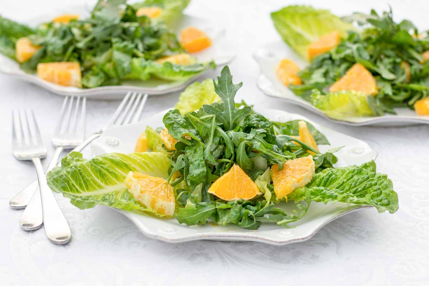 Product Photography: 3 plates of Orang & Arugula Salad from The Noil Kitchen